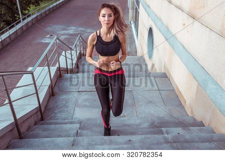 Tanned Woman, Fitness Instructor Girl Running Upstairs Jump Athlete Jogging Morning, In Summer In Ci