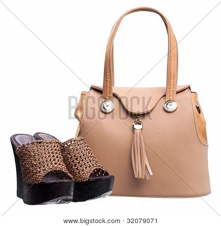 Pair of women open-toe clogs and handbag