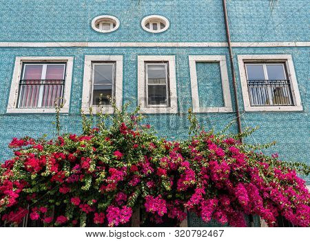 Decorative Ceramic Tiles On A Large House With Colorful Flowers In Alfama District Of Lisbon, Portug