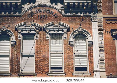poster of Beautiful historic building with old large windows, outdoor lights in a historic place of Denver city.