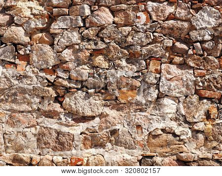 Rough Wall Made Of Natural Stone And Boulders
