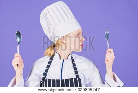 Following Eating Utensils Etiquette. Pretty Woman Holding Stainless Steel Utensils. Sexy Cook With C