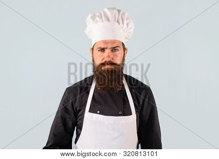 Bearded Chef In Uniform, Hat And Apron. Professional Chef, Cook Or Baker. Chief Cook And Professiona