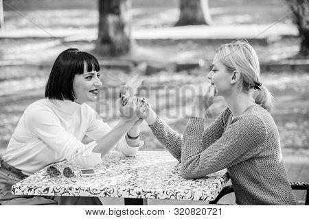 Friendship Meeting. Girls Friends Drink Coffee Talk. Conversation Of Two Women Cafe Terrace. Friends