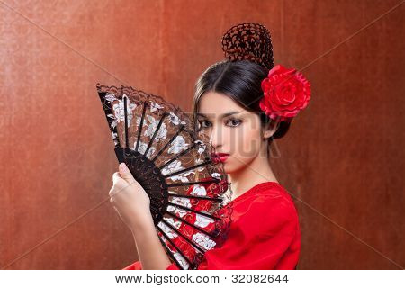 Gypsy flamenco dancer Spain girl with red rose spanish hand fan and peineta comb poster