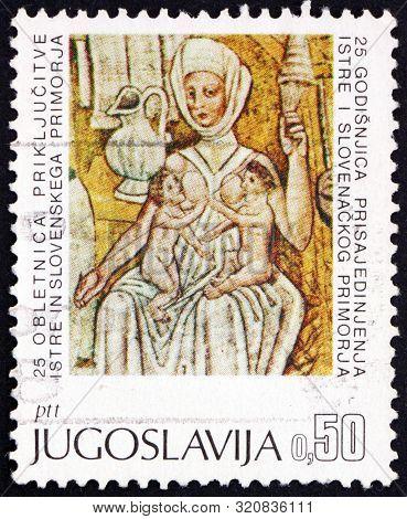 Yugoslavia - Circa 1968: A Stamp Printed In Yugoslavia Shows Mother Nursing Twins, Fresco By Jan Of