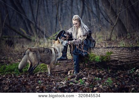 Viking Warrior Female With A Wolf In The Forest - Cinematic Medieval Scene