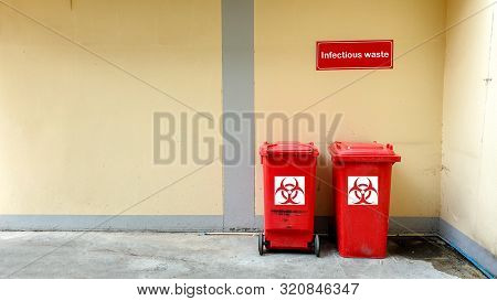 Infectious Waste Trashcan Front Of Building Wall In A Hospital. According To The World Health Organi