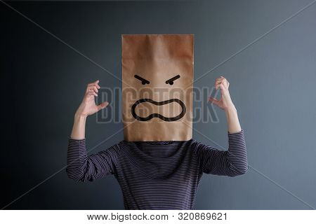 Customer Experience Or Human Emotional Concept. Woman Covered Her Face By Paper Bag And Present Angr