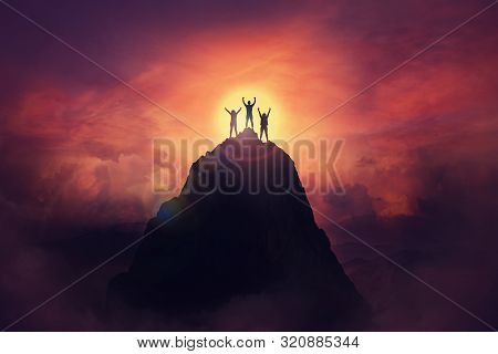Together Overcoming Obstacles As A Group Of Three People Raising Hands Up On The Top Of A Mountain.