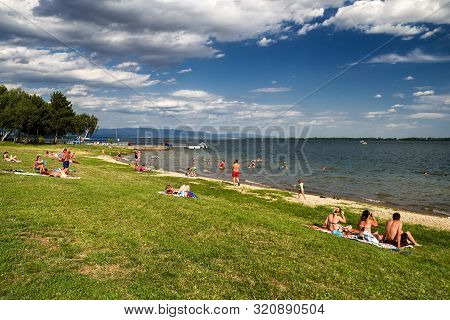 Vinne, Slovakia - July 6: People Relaxing On The Shore Of A Lake  Zemplinska Sirava On July 6, 2019