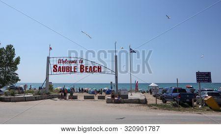 Sauble Beach, Ontario / Canada -  August 05, 2019:  Sauble Beach tourist destination, Bruce Peninsula attraction along the eastern shore of Lake Huron, Sable beach entrance gate