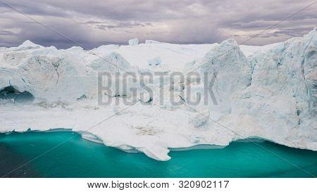 Greenland Iceberg landscape of Ilulissat icefjord with giant icebergs. Icebergs from melting glacier. Arctic nature.