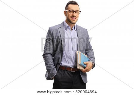 Young man holding books and smiling at the camera isolated on white background