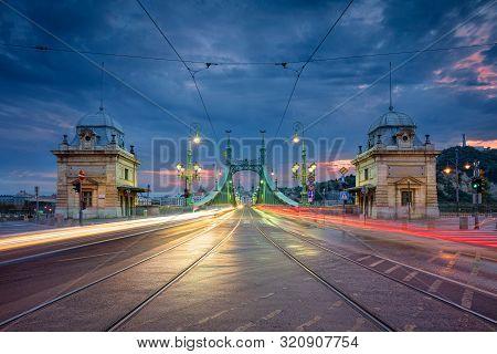 Budapest, Hungary. Cityscape Image Of Budapest With Liberty Bridge During Twilight Blue Hour.