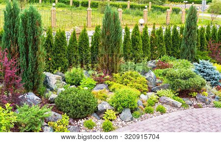 Landscape Design With Plants And Flowers At Residential House. Landscaping Panorama Of Home Garden.
