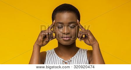 Concentration. Afro Girl Holding Fingers On Temples, Thinking Hard, Trying To Concentrate, Yellow St