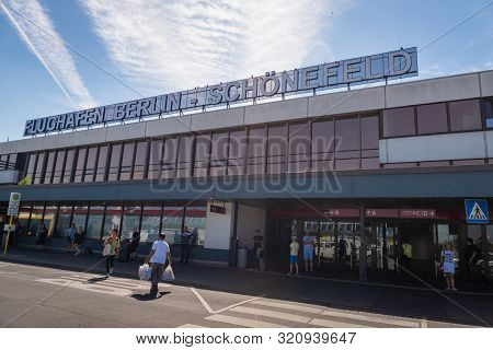 Berlin, Germany - July 2019: Facade Of Berlin Schonefeld Airport And Passengers In Berlin, Germany.
