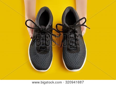 Sport Shoes Isolated On Yellow Background. Black Sneakers Running Shoes. Casual Shoes. Youth Style.