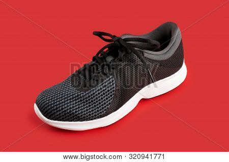 Sport Shoes Isolated On Red Background. Black Sneakers Running Shoes. Casual Shoes. Youth Style. Sho