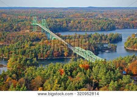 Thousand Islands Bridge Across St. Lawrence River In Fall In Thousand Islands National Park. This Br