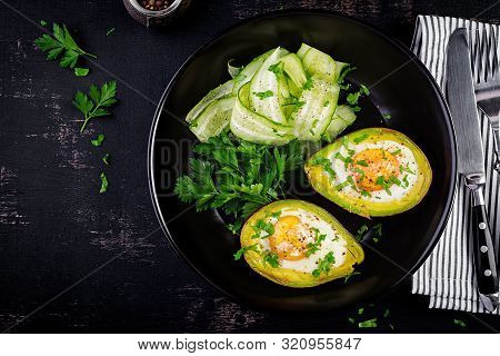 Avocado Baked With Egg And Fresh Salad. Vegetarian Dish. Top View, Overhead.  Ketogenic Diet. Keto F