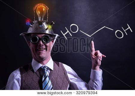Nerd Presenting Handdrawn Chemical Formula Of Ethylene Glycol