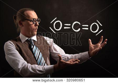 Professor Presenting Handdrawn Chemical Formula Of Co2