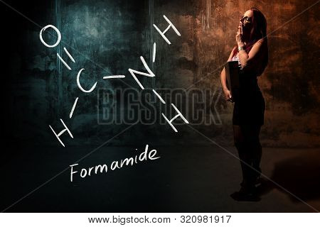 Sexy Girl Or Secretary Or Female Student Presenting Handdrawn Chemical Formula Of Formamide