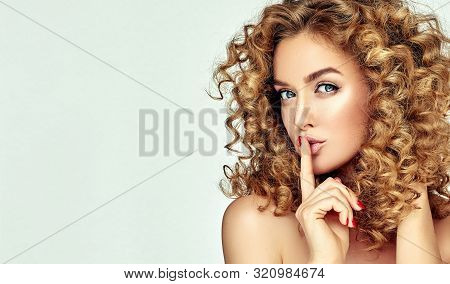 Woman With Red Lips And Nails Shouts In Surprise ,  And Joy.beautiful Girl  With Curly Hair Surprise