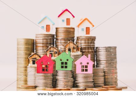 House Model On Coins Stack. Planning Savings Money Of Coins To Buy A Home Concept, Mortgage And Real
