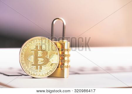 Bitcoin(btc) Coin With Padlock Lying On Computer Background. Bitcoin Security. Digital Cyber Safety