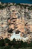 Monastery of Ostrog is a monastery of Serbian Orthodox Church placed against an almost vertical rock of Ostroska Greda, Montenegro, Europe. poster