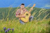 Summer music festival outdoors. Playing music. Sound of freedom. Inspired musician play rock ballad. Compose melody. Inspiring environment. Man with guitar on top of mountain. Acoustic music poster