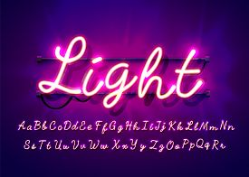 Neon Tube Hand Drawn Alphabet Font. Script Type Letters On A Dark Background. Vector Typeface For La