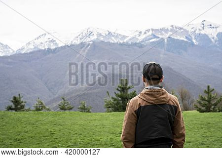 Young Man In Cap From Behind Looking View Of Snow Capped Peak Caucasus Mountains, Travel, Mountain L