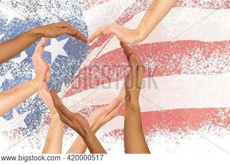 Hands On The Background Of The Flag Of America. Hands With Flag Of United States Of America. America