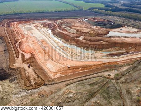 Opencast mining quarry . Industrial Extraction of lime, chalk, sand, calx, caol. top Aerial view