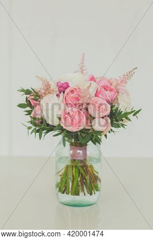 White And Pink Rose Flowers In Glass Vase On White