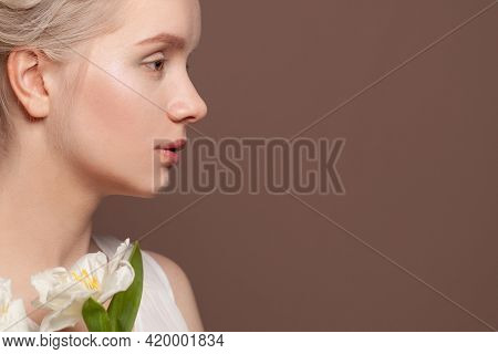 Beautiful Female Profile White Flowers On Brown Background