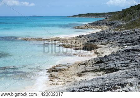 The View Of A Wild Rocky Beach And Transparent Waters On Half Moon Cay (bahamas).