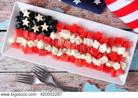 American Flag Salad With Watermelon, Blueberries And Feta Cheese. Top View Table Scene Against A Rus