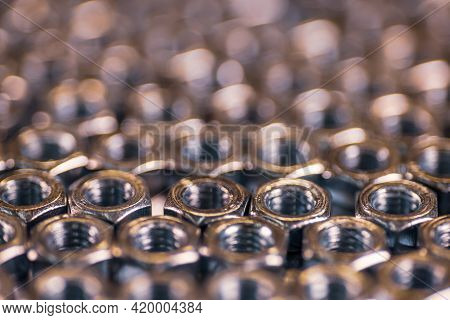 Close-up Chrome Metal Nuts In The Form Of Honeycombs