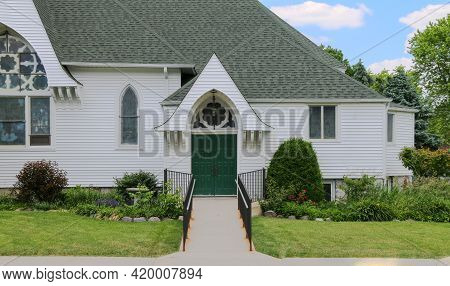 Unique Style Architecture Vintage Church Facade With Green Door Shot As A Religious Landscape Scene
