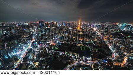 Cityscape High Angle View Tokyo City Downtown District With Tokyo Tower And Light Trail Of Car Traff