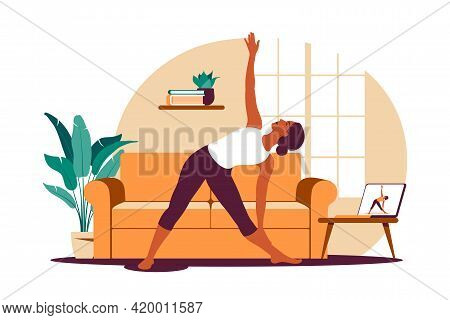 Online Workout. Woman Doing Yoga At Home. Watching Tutorials On A Laptop. Sport Exercise In A Cozy I