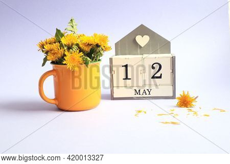 Calendar For May 12: Cubes With The Number 12, The Name Of The Month Of May In English, A Bouquet Of