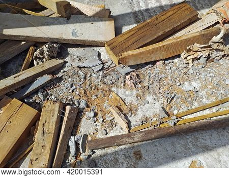 Background Of Remnants Of Old Wooden Planks, Chips And Scraps Of Carpentry. Construction Debris Patt