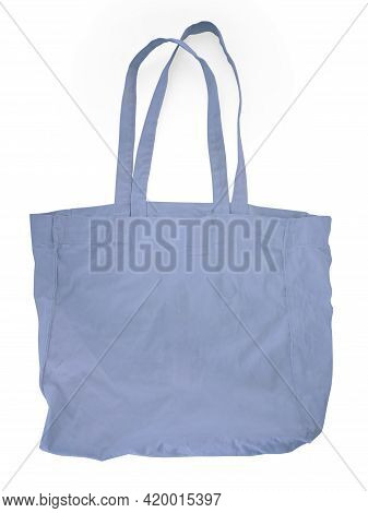 Close Up Of Blue Canvas Tote. Cotton Cloth Bag Isolated On White Background. Front View Of Blank Sho
