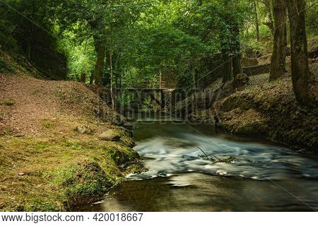 Water Stream Of Lourido River In The Park Of The Estalisnau Fountain In Maceda - Ovar, Portugal.